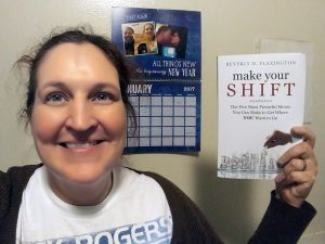 Carma holds a copy of Make Your Shift
