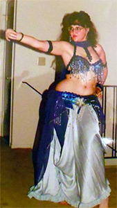 Carma belly dancing to the James Bond theme